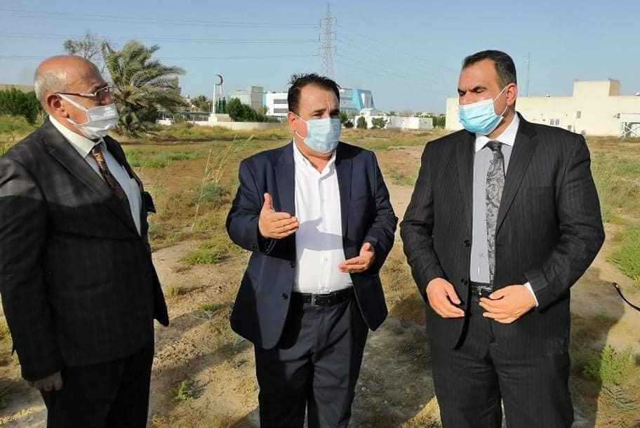 Iraqi officials inspect a field in Wasit which has been designated for construction of a specialised coronavirus hospital within a month